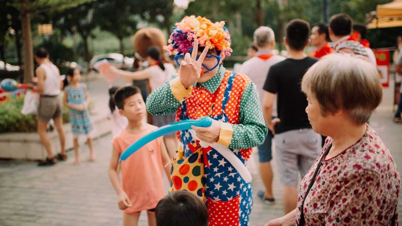 clown doing peace hand gesture